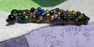 The body is made in multicolored beads to mimic the irridescence of dragonfllies.